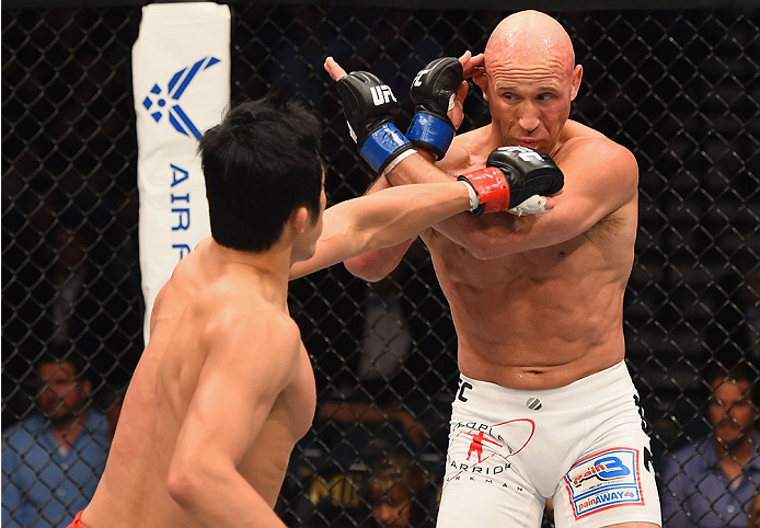 LAS VEGAS, NV - MAY 23:  (L-R) Dong Hyun Kim punches Josh Burkman in their welterweight bout during the UFC 187 event at the MGM Grand Garden Arena on May 23, 2015 in Las Vegas, Nevada.  (Photo by Josh Hedges/Zuffa LLC/Zuffa LLC via Getty Images)