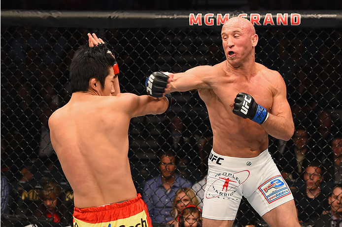 LAS VEGAS, NV - MAY 23:  (R-L) Josh Burkman punches Dong Hyun Kim in their welterweight bout during the UFC 187 event at the MGM Grand Garden Arena on May 23, 2015 in Las Vegas, Nevada.  (Photo by Josh Hedges/Zuffa LLC/Zuffa LLC via Getty Images)