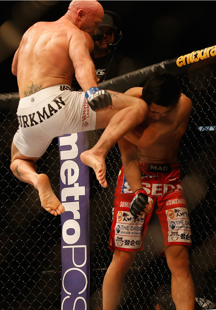 LAS VEGAS, NV - MAY 23:  (L-R) Josh Burkman knees Dong Hyun Kim in their welterweight bout during the UFC 187 event at the MGM Grand Garden Arena on May 23, 2015 in Las Vegas, Nevada.  (Photo by Christian Petersen/Zuffa LLC/Zuffa LLC via Getty Images)