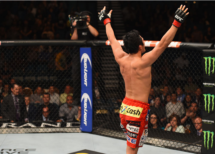 LAS VEGAS, NV - MAY 23:  Dong Hyun Kim reacts to his victory over Josh Burkman in their welterweight bout during the UFC 187 event at the MGM Grand Garden Arena on May 23, 2015 in Las Vegas, Nevada.  (Photo by Josh Hedges/Zuffa LLC/Zuffa LLC via Getty Images)