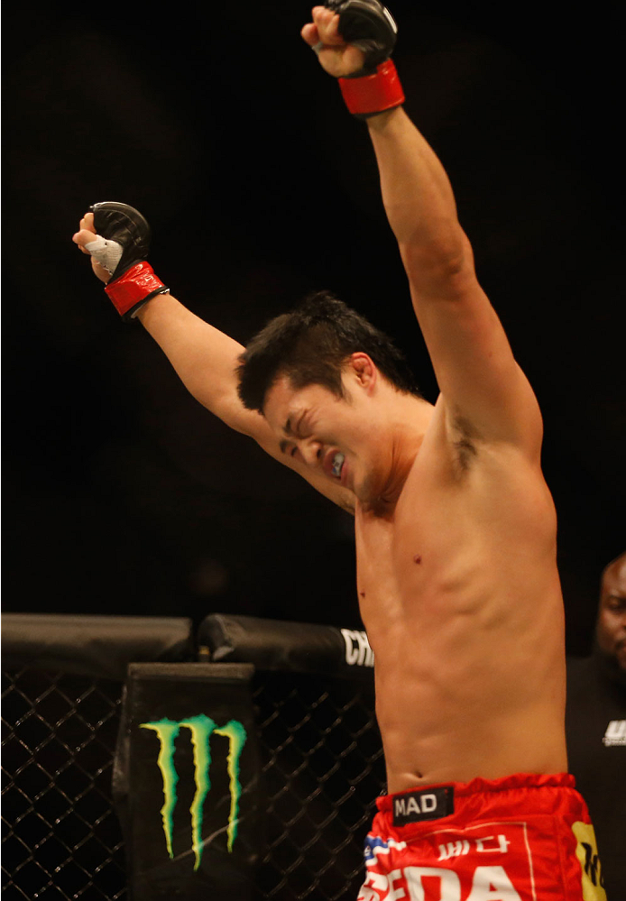 LAS VEGAS, NV - MAY 23:  (L-R) Dong Hyun Kim reacts to his victory over Josh Burkman in their welterweight bout during the UFC 187 event at the MGM Grand Garden Arena on May 23, 2015 in Las Vegas, Nevada.  (Photo by Christian Petersen/Zuffa LLC/Zuffa LLC via Getty Images)