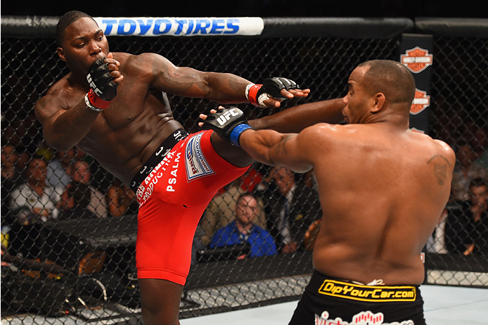 LAS VEGAS, NV - MAY 23: (L-R) Anthony Johnson kicks Daniel Cormier in their UFC light heavyweight championship bout during the UFC 187 event at the MGM Grand Garden Arena on May 23, 2015 in Las Vegas, Nevada. (Photo by Josh Hedges/Zuffa LLC)