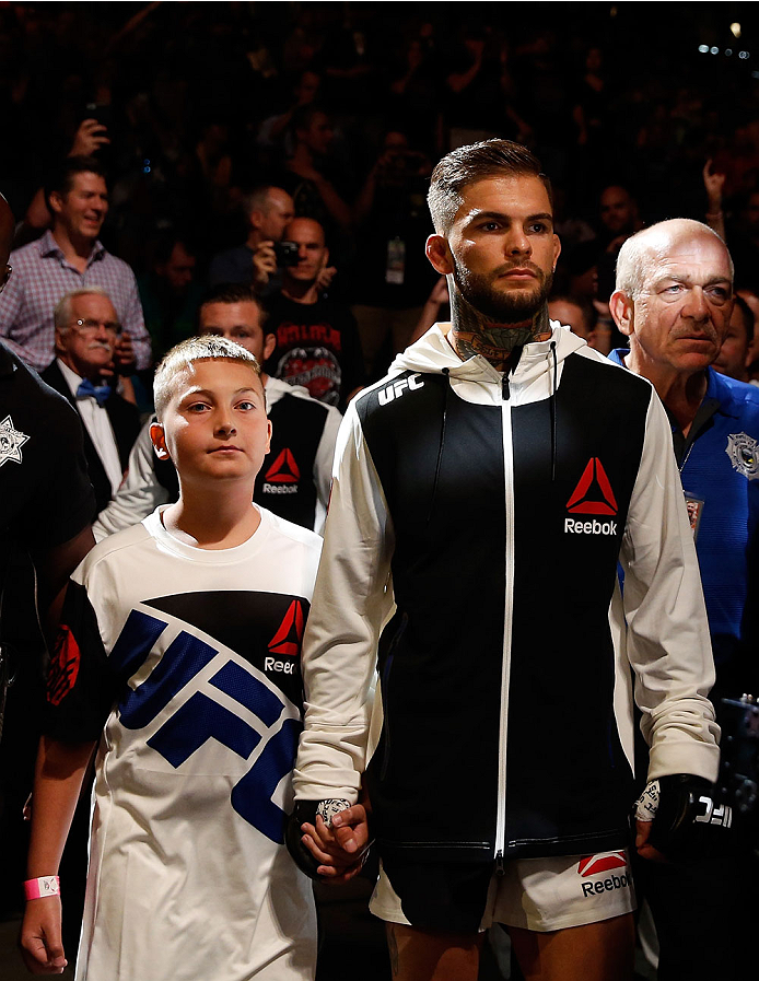 Cody Garbrandt and a young fan walk to the Octagon during the UFC 189 event inside MGM Grand Garden Arena on July 11, 2015 in Las Vegas, NV. (Photo by Christian Petersen/Zuffa LLC)