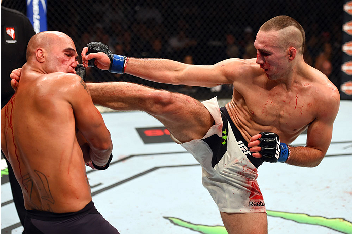 Robbie Lawler kicks Rory MacDonald in their UFC welterweight title fight during the UFC 189 event inside MGM Grand Garden Arena on July 11, 2015 in Las Vegas, NV. (Photo by Josh Hedges/Zuffa LLC)