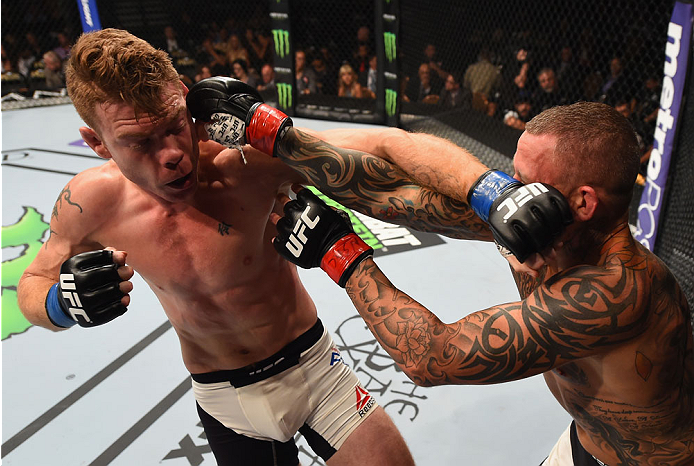 LAS VEGAS, NV - SEPTEMBER 05: (L-R) Paul Felder punches Ross Pearson in their lightweight bout during the UFC 191 event inside MGM Grand Garden Arena on September 5, 2015 in Las Vegas, Nevada.  (Photo by Josh Hedges/Zuffa LLC/Zuffa LLC via Getty Images) *** Local Caption *** Ross Pearson; Paul Felder