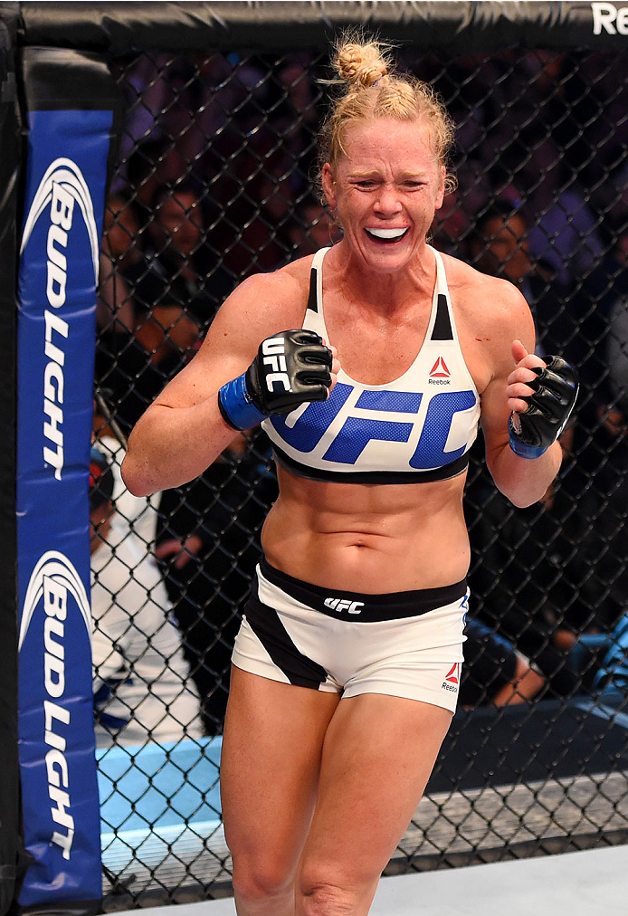 Holly Holm celebrates after defeating <a href='../fighter/Ronda-Rousey'>Ronda Rousey</a> to become the UFC women's bantamweight champion