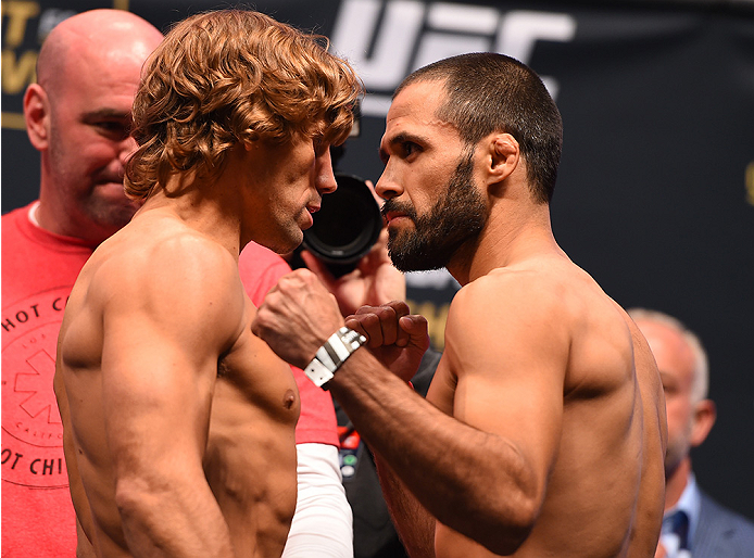 LAS VEGAS, NV - DECEMBER 11:   (L-R) Opponents Urijah Faber and Frankie Saenz face off during the UFC 194 weigh-in inside MGM Grand Garden Arena on December 10, 2015 in Las Vegas, Nevada.  (Photo by Josh Hedges/Zuffa LLC/Zuffa LLC via Getty Images)