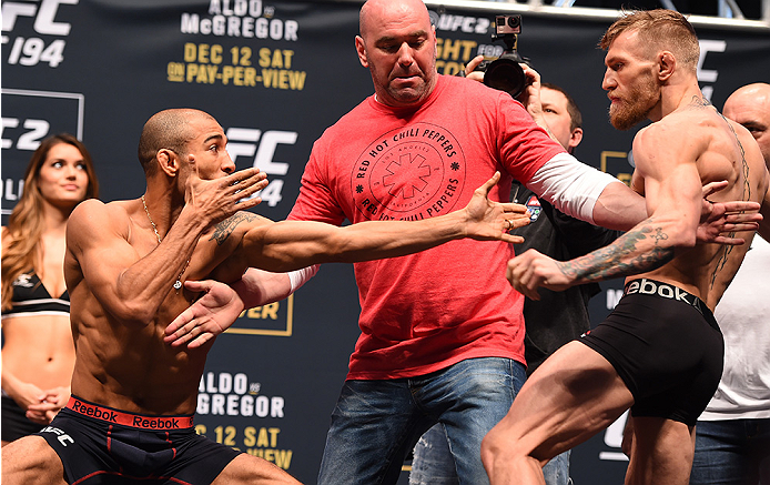 LAS VEGAS, NV - DECEMBER 11:  (L-R) UFC featherweight champion Jose Aldo of Brazil and interim UFC featherweight champion Conor McGregor of Ireland face off during the UFC 194 weigh-in inside MGM Grand Garden Arena on December 10, 2015 in Las Vegas, Nevada.  (Photo by Josh Hedges/Zuffa LLC/Zuffa LLC via Getty Images)