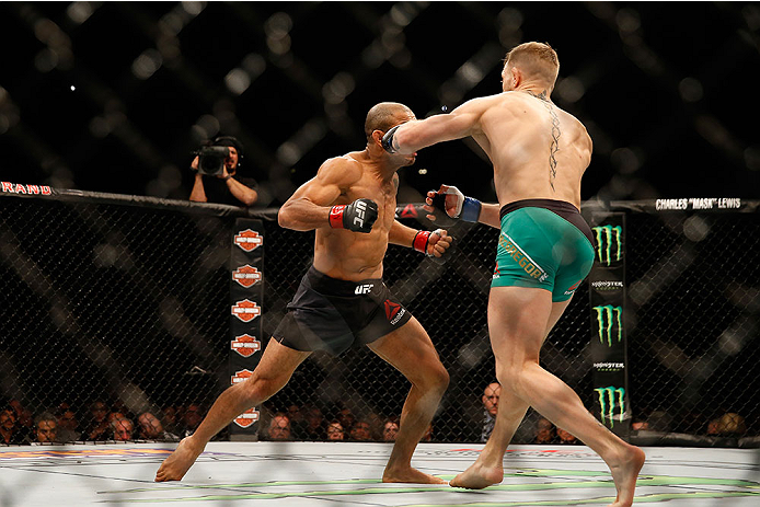 <a href='../fighter/Conor-McGregor'>Conor McGregor</a> knocks out <a href='../fighter/Jose-Aldo'>Jose Aldo</a> just 13 seconds into their featherweight bout at UFC 194
