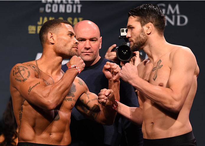 LAS VEGAS, NV - JANUARY 01:   (L-R) Opponents Abel Trujillo and Tony Sims face off during the UFC 195 weigh-in at the MGM Grand Conference Center on January 1, 2016 in Las Vegas, Nevada. (Photo by Josh Hedges/Zuffa LLC/Zuffa LLC via Getty Images)