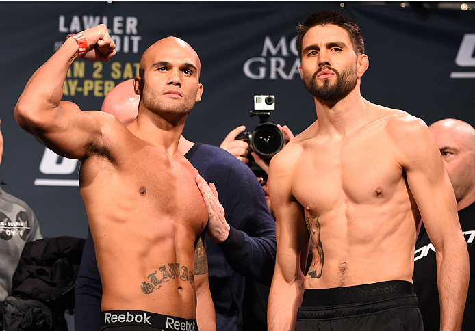 LAS VEGAS, NV - JANUARY 01:   (L-R) UFC welterweight champion Robbie Lawler and opponent Carlos Condit pose for photos during the UFC 195 weigh-in at the MGM Grand Conference Center on January 1, 2016 in Las Vegas, Nevada. (Photo by Josh Hedges/Zuffa LLC/Zuffa LLC via Getty Images)