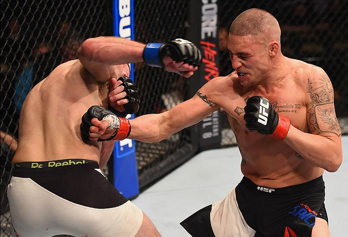 LAS VEGAS, NV - MARCH 05: (R-L) Diego Sanchez punches Jim Miller in their lightweight bout during the UFC 196 event inside MGM Grand Garden Arena on March 5, 2016 in Las Vegas, Nevada.  (Photo by Josh Hedges/Zuffa LLC/Zuffa LLC via Getty Images) *** Local Caption *** Diego Sanchez; Jim Miller