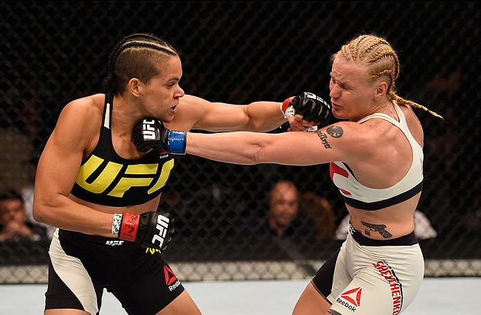 LAS VEGAS, NV - MARCH 05: (L-R) Amanda Nunes of Brazil punches Valentina Shevchenko of Peru in their women's bantamweight bout during the UFC 196 event inside MGM Grand Garden Arena on March 5, 2016 in Las Vegas, Nevada.  (Photo by Josh Hedges/Zuffa LLC/Zuffa LLC via Getty Images) *** Local Caption *** Amanda Nunes; Valentina Shevchenko