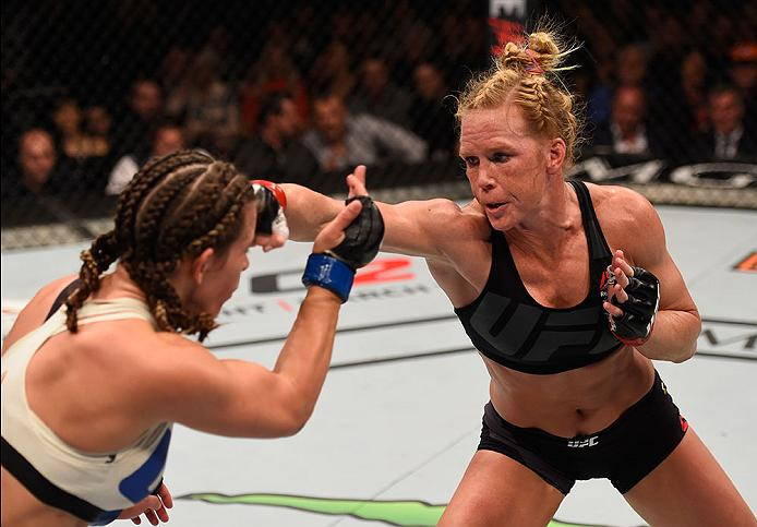LAS VEGAS, NV - MARCH 05: (L-R) Holly Holm punches Miesha Tate in their UFC women's bantamweight championship bout during the UFC 196 event inside MGM Grand Garden Arena. (Photo by Josh Hedges/Zuffa LLC)