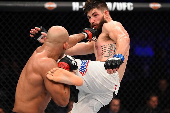 CURITIBA, BRAZIL - MAY 14: (R-L) Bryan Barberena kicks Warlley Alves of Brazil in their middleweight bout during the UFC 198 event at Arena da Baixada stadium on May 14, 2016 in Curitiba, Parana, Brazil. (Photo by Josh Hedges/Zuffa LLC)