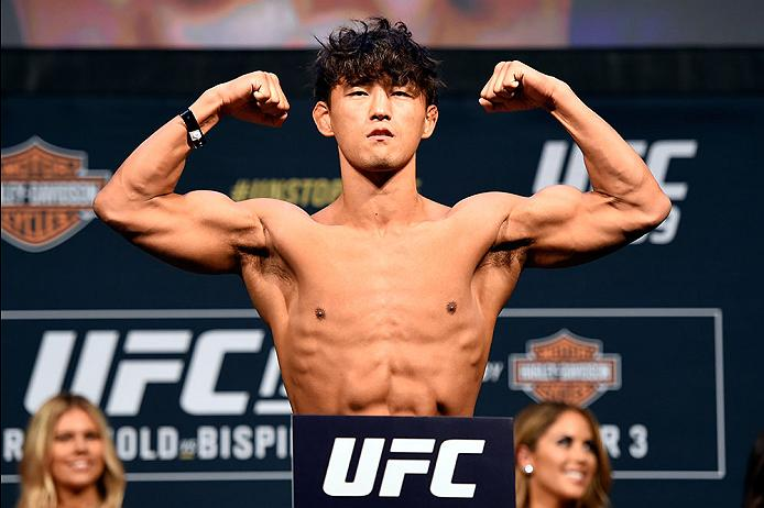 INGLEWOOD, CA - JUNE 03:   Dong Hyun Kim of South Korea steps on the scale during the UFC 199 weigh-in at the Forum on June 3, 2016 in Inglewood, California. (Photo by Josh Hedges/Zuffa LLC/Zuffa LLC via Getty Images)