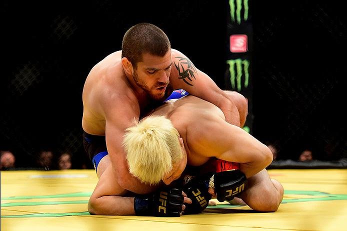 LAS VEGAS, NV - JULY 09: Jim Miller (top) wrestles with Takanori Gomi of Japan in their lightweight bout during the UFC 200 event on July 9, 2016 at T-Mobile Arena in Las Vegas, Nevada.  (Photo by Harry How/Zuffa LLC/Zuffa LLC via Getty Images) *** Local Caption *** Jim Miller; Takanori Gomi