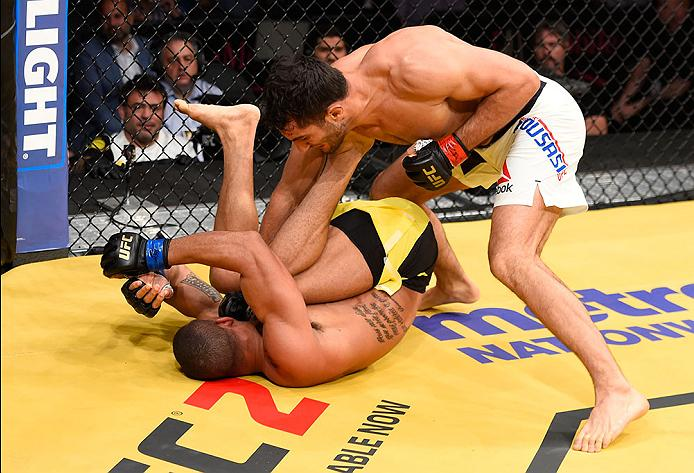 LAS VEGAS, NV - JULY 09: Gegard Mousasi of The Netherlands (top) punches Thiago Santos of Brazil in their middleweight bout during the UFC 200 event on July 9, 2016 at T-Mobile Arena in Las Vegas, Nevada. (Photo by Josh Hedges/Zuffa LLC/Zuffa LLC via Getty Images) *** Local Caption *** Gegard Mousasi; Thiago Santos