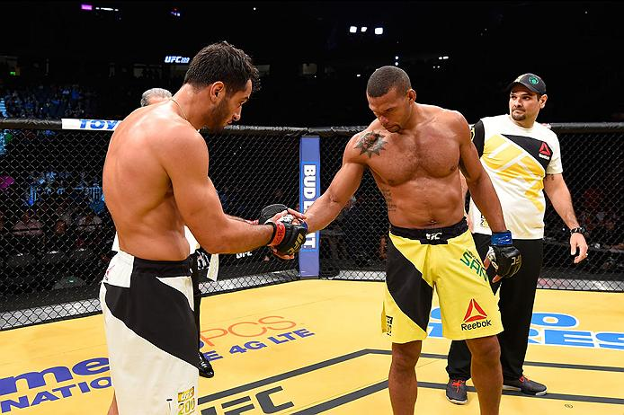 LAS VEGAS, NV - JULY 09: (L-R) Gegard Mousasi of The Netherlands and Thiago Santos of Brazil shake hands after their middleweight bout during the UFC 200 event on July 9, 2016 at T-Mobile Arena in Las Vegas, Nevada. (Photo by Josh Hedges/Zuffa LLC/Zuffa LLC via Getty Images) *** Local Caption *** Gegard Mousasi; Thiago Santos