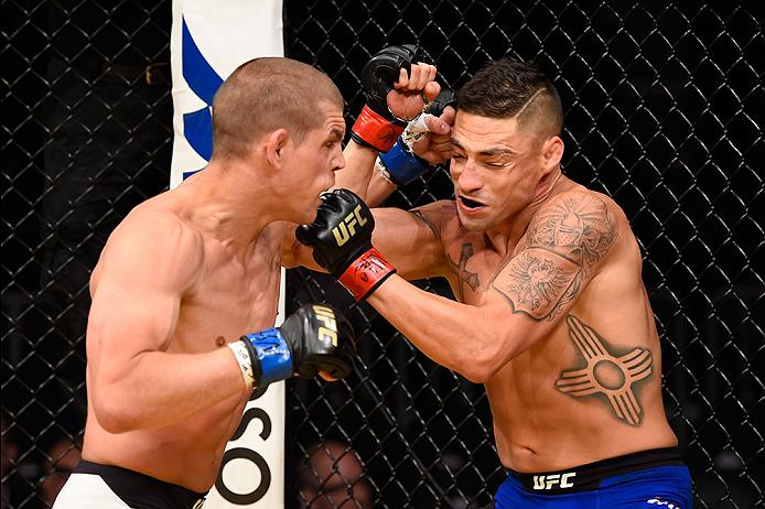 <a href='../fighter/Joe-Lauzon'>Joe Lauzon</a> punches Diego Sanchez during their fight at UFC 200