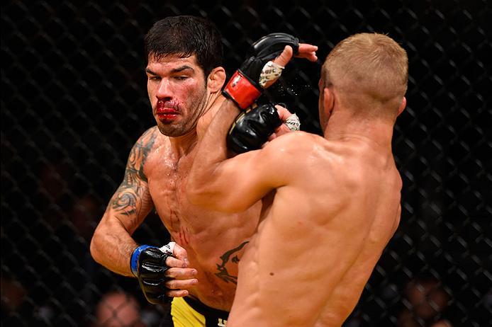 LAS VEGAS, NV - JULY 09: (L-R) Raphael Assuncao of Brazil punches TJ Dillashaw in their bantamweight bout during the UFC 200 event on July 9, 2016 at T-Mobile Arena in Las Vegas, Nevada. (Photo by Josh Hedges/Zuffa LLC/Zuffa LLC via Getty Images) *** Local Caption *** TJ Dillashaw; Raphael Assuncao