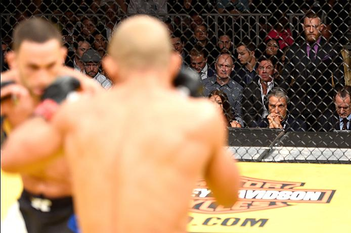 LAS VEGAS, NV - JULY 09: UFC featherweight champion Conor McGregor (right) watches Jose Aldo of Brazil vs Frankie Edgar in their UFC interim featherweight championship bout during the UFC 200 event on July 9, 2016 at T-Mobile Arena in Las Vegas, Nevada. (Photo by Josh Hedges/Zuffa LLC/Zuffa LLC via Getty Images) *** Local Caption *** Jose Aldo; Frankie Edgar; Conor McGregor