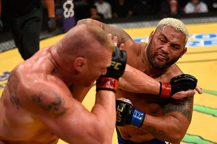 LAS VEGAS, NV - JULY 09: (R-L) Mark Hunt of New Zealand punches Brock Lesnar in their heavyweight bout during the UFC 200 event on July 9, 2016 at T-Mobile Arena in Las Vegas, Nevada. (Photo by Josh Hedges/Zuffa LLC/Zuffa LLC via Getty Images) *** Local Caption *** Brock Lesnar; Mark Hunt