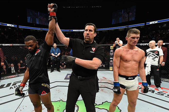 <a href='../fighter/Tyron-Woodley'>Tyron Woodley</a> gets his hand raised after defeating <a href='../fighter/Stephen-Thompson'>Stephen Thompson</a> by decision at UFC 209