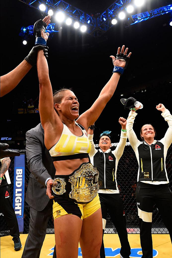 Amanda Nunes celebrates her victory at UFC 200 when she became the women's bantamweight champion