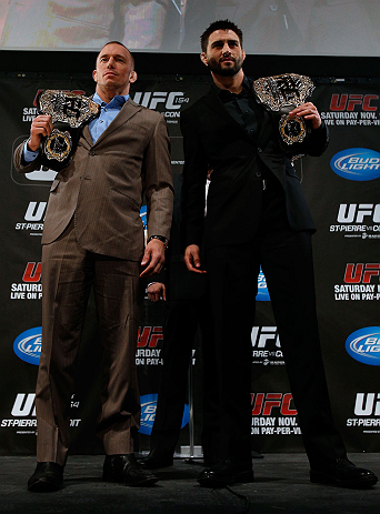 MONTREAL, CANADA - NOVEMBER 14:  (L-R) Opponents Georges St-Pierre and Carlos Condit pose for photos during the final pre-fight press conference ahead of UFC 154 at New City Gas on November 14, 2012 in Montreal, Quebec, Canada.  (Photo by Josh Hedges/Zuffa LLC/Zuffa LLC via Getty Images)