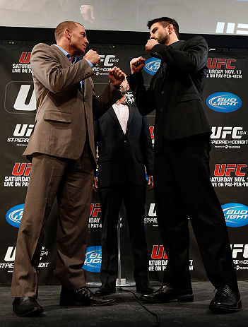 MONTREAL, CANADA - NOVEMBER 14:  (L-R) Opponents Georges St-Pierre and Carlos Condit face off during the final pre-fight press conference ahead of UFC 154 at New City Gas on November 14, 2012 in Montreal, Quebec, Canada.  (Photo by Josh Hedges/Zuffa LLC/Zuffa LLC via Getty Images)