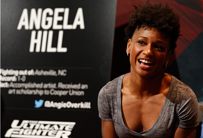 LAS VEGAS, NV - JULY 03:  The Ultimate Fighter season 20 cast member Angela Hill interacts with media during the UFC Ultimate Media Day at the Mandalay Bay Resort and Casino on July 3, 2014 in Las Vegas, Nevada.  (Photo by Josh Hedges/Zuffa LLC/Zuffa LLC via Getty Images)