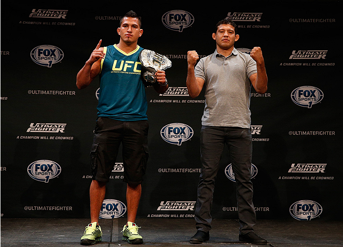 LAS VEGAS, NV - JULY 03:  (L-R) UFC lightweight champion Anthony Pettis and upcoming opponent Gilbert Melendez pose for photos during the UFC Ultimate Media Day at the Mandalay Bay Resort and Casino on July 3, 2014 in Las Vegas, Nevada.  (Photo by Josh Hedges/Zuffa LLC/Zuffa LLC via Getty Images)