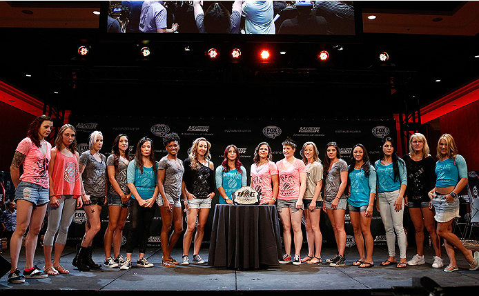 LAS VEGAS, NV - JULY 03:  A general view of the entire cast of The Ultimate Fighter season 20 is seen on stage with the UFC strawweight title belt during the UFC Ultimate Media Day at the Mandalay Bay Resort and Casino on July 3, 2014 in Las Vegas, Nevada.  (Photo by Josh Hedges/Zuffa LLC/Zuffa LLC via Getty Images)