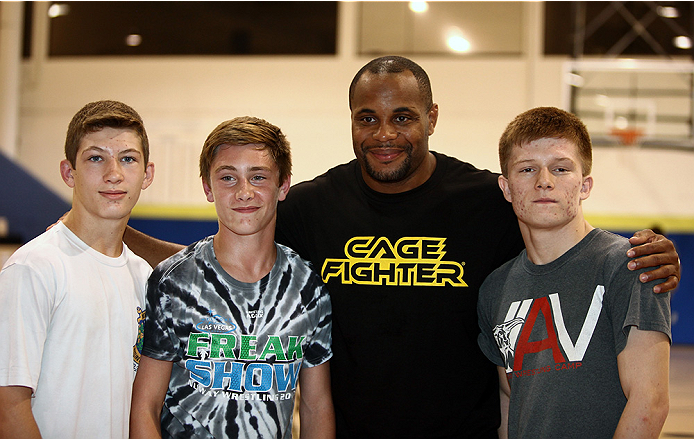 LAS VEGAS, NV - JULY 1:  UFC fighter Daniel Cormier poses with fans as the UFC, Ultimate Alliance and Boys & Girls Club of Las Vegas announce a partnership to host after school wrestling programs to kick off the UFC International Fight Week at the Boys & Girls Club of Southern Nevada on July 1, 2014 in Las Vegas, Nevada. (Photo by Brandon Magnus/Zuffa LLC/Zuffa LLC via Getty Images)