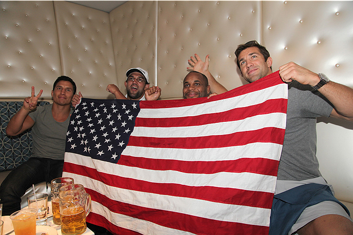 LAS VEGAS, NV - JULY 1:  (L-R) Joseph Benavidez, UFC Welterweight Champ Johnny Hendricks, Daniel Cormier, and Luke Rockhold watch the 2014 FIFA World Cup Brazil Round of 16 match between USA and Belgium with fans to kick off the UFC International Fight Week at Legasse's Stadium at The Palazzo Las Vegas on July 1, 2014 in Las Vegas, Nevada. (Photo by Brandon Magnus/Zuffa LLC/Zuffa LLC via Getty Images)
