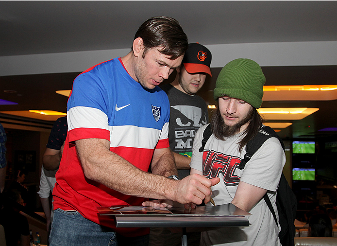 LAS VEGAS, NV - JULY 1:  Forrest Griffin signs an autograph for a fan during the 2014 FIFA World Cup Brazil Round of 16 match between USA and Belgium to kick off the UFC International Fight Week at Legasse's Stadium at The Palazzo Las Vegas on July 1, 2014 in Las Vegas, Nevada. (Photo by Brandon Magnus/Zuffa LLC/Zuffa LLC via Getty Images)