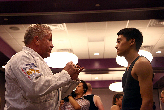 LAS VEGAS, NV - JULY 1:  UFC VP of Community Relations Reed Harris (L) instructs a self defense class to kick off the UFC International Fight Week at the Gay and Lesbian Community Center of Southern Nevada on July 1, 2014 in Las Vegas, Nevada. (Photo by Brandon Magnus/Zuffa LLC/Zuffa LLC via Getty Images)