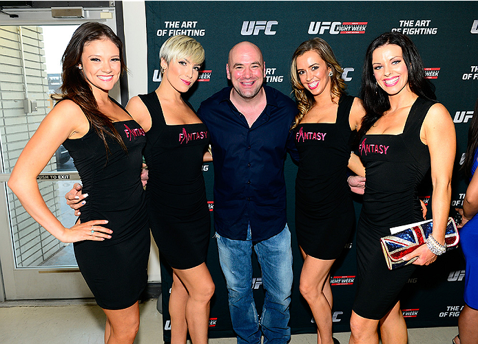 LAS VEGAS, NV - JULY 1:  (L-R) Cast members from the production show Fantasy, Danielle, Kristin, UFC President Dana White, Tracey and Mariah pose in front of art work at the Art of Fighting Exhibition to kick off the UFC International Fight Week at The Gallery on 1217 on July 1, 2014 in Las Vegas, Nevada. (Photo by Jeff Bottari/Zuffa LLC/Zuffa LLC via Getty Images)