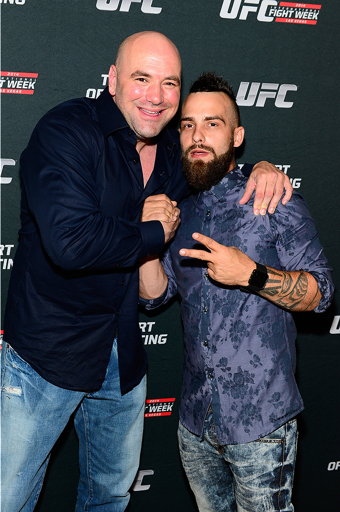 LAS VEGAS, NV - JULY 1:  (L-R) UFC President Dana White and artist Brian Kirhagis arrive at the Art of Fighting Exhibition to kick off the UFC International Fight Week at The Gallery on 1217 on July 1, 2014 in Las Vegas, Nevada. (Photo by Jeff Bottari/Zuffa LLC/Zuffa LLC via Getty Images)