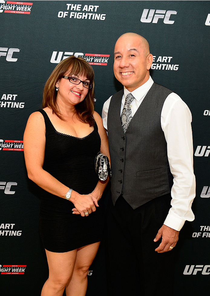 LAS VEGAS, NV - JULY 1:  (R-L) UFC DJ Albert Lineses III aka Almf3 arrives with his wife Mellissa at the Art of Fighting Exhibition to kick off the UFC International Fight Week at The Gallery on 1217 on July 1, 2014 in Las Vegas, Nevada. (Photo by Jeff Bottari/Zuffa LLC/Zuffa LLC via Getty Images)