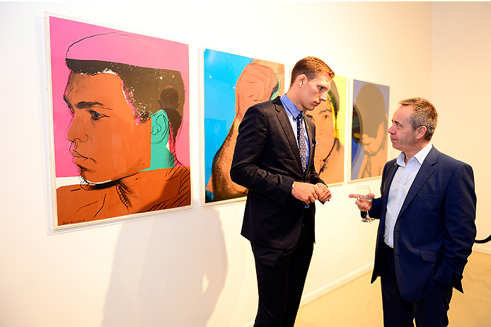 LAS VEGAS, NV - JULY 1:  UFC middleweight fighter Luke Barnatt mingles with a guest at the Art of Fighting Exhibition to kick off the UFC International Fight Week at The Gallery on 1217 on July 1, 2014 in Las Vegas, Nevada. (Photo by Jeff Bottari/Zuffa LLC/Zuffa LLC via Getty Images)