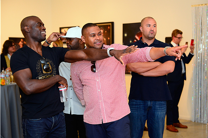 LAS VEGAS, NV - JULY 1:  UFC middleweight fighter Uriah Hall examines artwork with a guest at the Art of Fighting Exhibition to kick off the UFC International Fight Week at The Gallery on 1217 on July 1, 2014 in Las Vegas, Nevada. (Photo by Jeff Bottari/Zuffa LLC/Zuffa LLC via Getty Images)