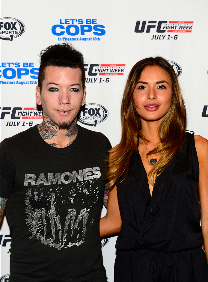 LAS VEGAS, NV - JULY 2: Guns N' Roses guitarist 'DJ' Ashba and a guest arrive at the UFC's Advance Screening of the Twentieth Century Fox film 'Let's Be Cops' during UFC International Fight Week at Brooklyn Bowl Las Vegas at The LINQ on July 2, 2014 in Las Vegas, Nevada. (Photo by Brandon Magnus/Zuffa LLC/Zuffa LLC via Getty Images)