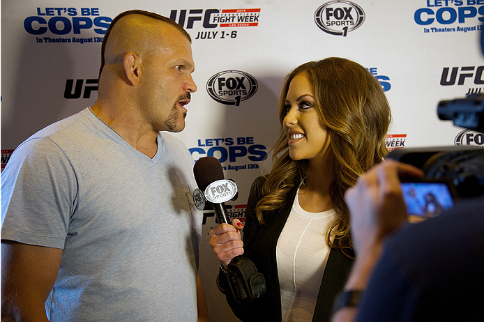 LAS VEGAS, NV - JULY 2:  UFC legend Chuck Liddell (L) is interviewed by UFC Octagon Girl Brittney Palmer at the advanced screening of the Twentieth Century Fox film 'Let's Be Cops' during UFC International Fight Week at Brooklyn Bowl Las Vegas at The LINQ on July 2, 2014 in Las Vegas, Nevada. (Photo by Al Powers/Zuffa LLC/Zuffa LLC via Getty Images)