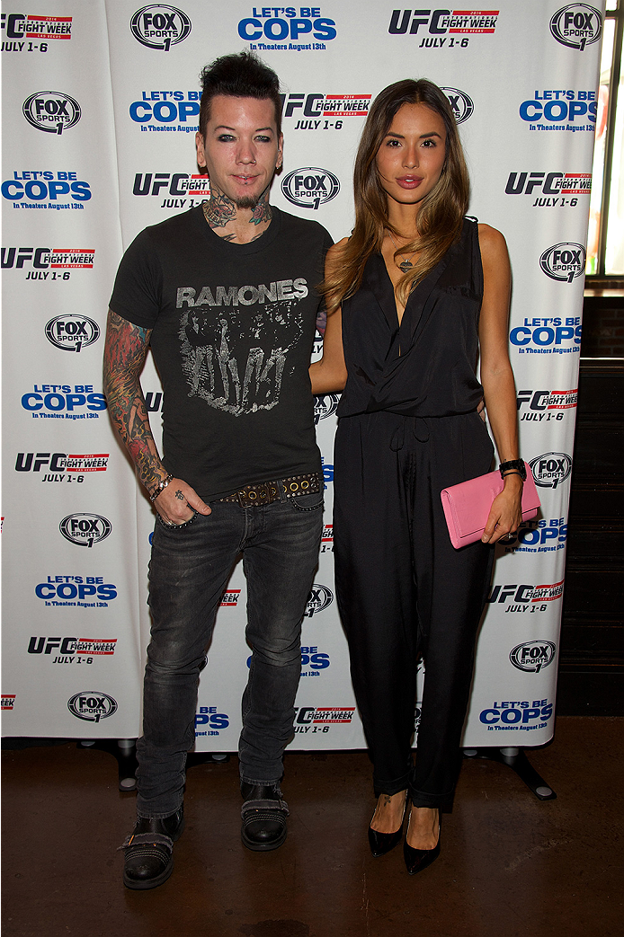 LAS VEGAS, NV - JULY 2:  Guitarist Dj Ashba of Guns N' Roses (L) and wife Nathalia Henao arrives at the advanced screening of the Twentieth Century Fox film 'Let's Be Cops' during UFC International Fight Week at Brooklyn Bowl Las Vegas at The LINQ on July 2, 2014 in Las Vegas, Nevada. (Photo by Al Powers/Zuffa LLC/Zuffa LLC via Getty Images)