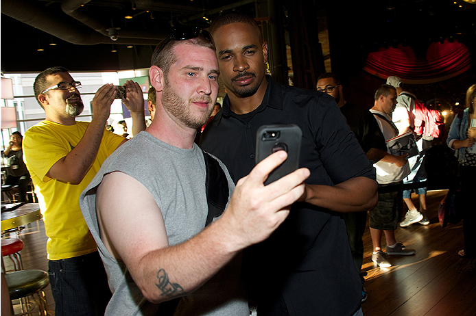 LAS VEGAS, NV - JULY 2:  Actor Damon Wayans Jr. (R) poses with fans at the advanced screening of the Twentieth Century Fox film 'Let's Be Cops' during UFC International Fight Week at Brooklyn Bowl Las Vegas at The LINQ on July 2, 2014 in Las Vegas, Nevada. (Photo by Al Powers/Zuffa LLC/Zuffa LLC via Getty Images)