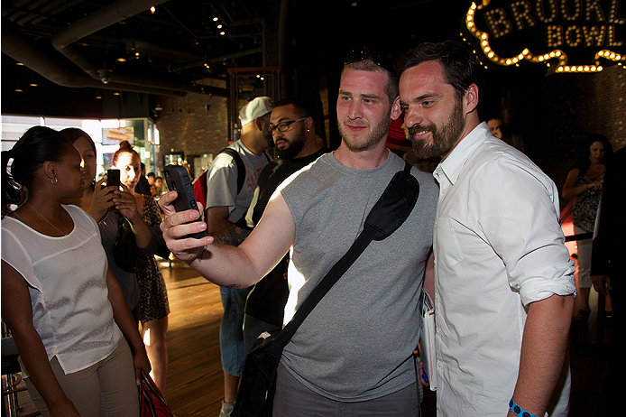 LAS VEGAS, NV - JULY 2:  Actor Jake Johnson (R) poses with a fan at the advanced screening of the Twentieth Century Fox film 'Let's Be Cops' during UFC International Fight Week at Brooklyn Bowl Las Vegas at The LINQ on July 2, 2014 in Las Vegas, Nevada. (Photo by Al Powers/Zuffa LLC/Zuffa LLC via Getty Images)