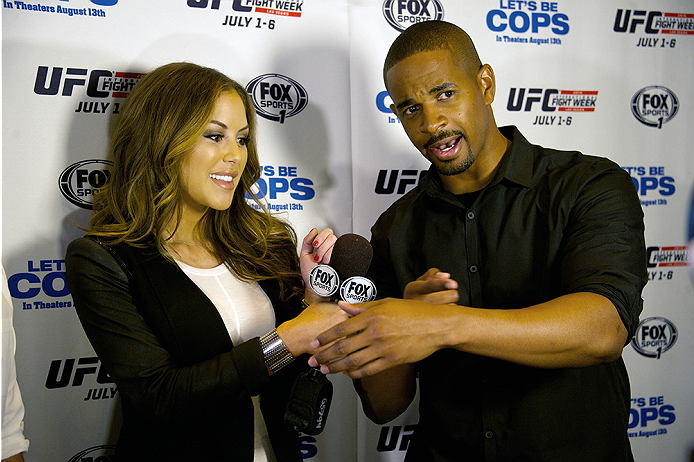 LAS VEGAS, NV - JULY 2:  UFC Octagon Girl Brittney Palmer (L) interviews actor Damon Wayans Jr. at the advanced screening of the Twentieth Century Fox film 'Let's Be Cops' during UFC International Fight Week at Brooklyn Bowl Las Vegas at The LINQ on July 2, 2014 in Las Vegas, Nevada. (Photo by Al Powers/Zuffa LLC/Zuffa LLC via Getty Images)