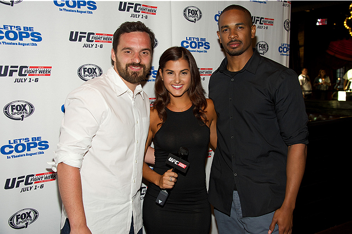 LAS VEGAS, NV - JULY 2:  (L-R) Actor Jake Johnson, UFC Fight Pass host Megan Olivi and actor Damon Wayans Jr. arrive at the advanced screening of the Twentieth Century Fox film 'Let's Be Cops' during UFC International Fight Week at Brooklyn Bowl Las Vegas at The LINQ on July 2, 2014 in Las Vegas, Nevada. (Photo by Al Powers/Zuffa LLC/Zuffa LLC via Getty Images)